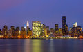 The buildings of manhattan in front of east river at night Royalty Free Stock Photos
