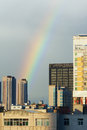 Buildings and rainbow the appeared in the sky over Stock Photography