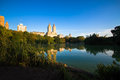 Buildings reflect in the lake at Central Park, New York Royalty Free Stock Photo