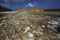 Buildings and rocky shoreline in Bonaire Stock Photo