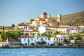 Buildings and the temple of a Greek harbor Galaxidi in Greece. Travel. Royalty Free Stock Photo