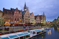 Buildings with tourboats ghent view of moored belgium Royalty Free Stock Photos