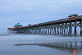 Built in and stretching feet over the atlantic ocean the edwin taylor folly beach pier is the place for fishing walking birding or Royalty Free Stock Photography