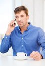 Buisnessman with cell phone and cup of coffee business communication modern technology concept Stock Photography