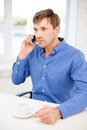 Buisnessman with cell phone and cup of coffee business communication modern technology concept Stock Photo