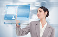Buisnesswoman using futuristic hologram to view social media profile on blue background Royalty Free Stock Photo