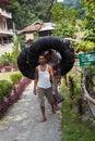 BUKIT LAWANG,INDONESIA - AUGUST 9,2012: Men carry car camera for