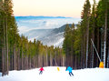 Bukovel ski resort skiers going down a slope at ukraine Royalty Free Stock Images