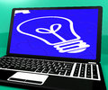 Bulb Puzzle On Notebook Showing Computer Energy Royalty Free Stock Photo