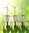 Bulb with wind turbine on plant Royalty Free Stock Photo