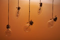 Bulbs hanging on an orange background Royalty Free Stock Photo