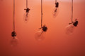 Bulbs hanging on an red background Royalty Free Stock Photo