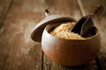 Bulgur wheat cracked and crushed that is an important cooking ingredient in middle eastern cuisine in a rustic pottery pot Stock Photos