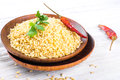 Bulgur in a wooden plate with red pepper Royalty Free Stock Photo
