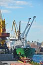 Bulk cargo ship under port crane Stock Images