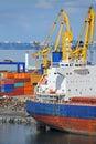 Bulk cargo ship under port crane bridge odessa ukraine Royalty Free Stock Photography