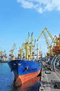 Bulk cargo ship under port crane bridge odessa ukraine Stock Photo