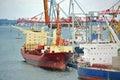 Bulk cargo ship under port crane bridge odessa ukraine Stock Images