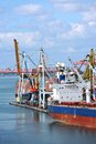 Bulk cargo ship under port crane bridge odessa ukraine Stock Image