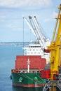 Bulk cargo ship under port crane bridge odessa ukraine Stock Photography