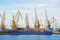 Bulk cargo ship under port crane bridge odessa ukraine Royalty Free Stock Photo