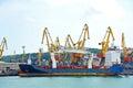 Bulk cargo ship under port crane bridge odessa ukraine Royalty Free Stock Image
