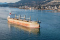 Bulk carrier cargo vessel heading to vancouver harbour Stock Photos