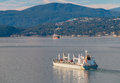 Bulk carrier cargo vessel leaves vancouver harbour Stock Images