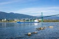 A bulk carrier ship passed under the lions gate bridge Royalty Free Stock Photo