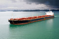 Bulk transport carrier under stormy sky Stock Photo