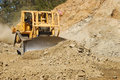 Bull basco large bulldozer working a rock outcrop on a new business development project in roseburg oregon Royalty Free Stock Image