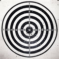Bull eye target with bullets holes Royalty Free Stock Photography