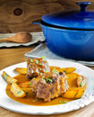 Bull tail stew spanish style with fried potatoes rustic cuisine Stock Images