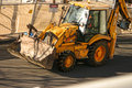 Bulldozer a big orange excavator at a construction building site Royalty Free Stock Image