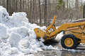 Bulldozer clearing snow Stock Photography
