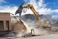 Bulldozer crushing building construction site Stock Image