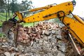 Bulldozer on demolition site working on an old building and load Royalty Free Stock Photo