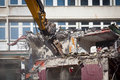 Bulldozer is destroying an old building Stock Photos