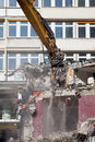 Bulldozer is destroying an old building Royalty Free Stock Photo