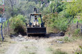 Bulldozer on dirt road man driving rural Stock Photo