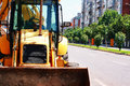 Bulldozer front view on the side of the road Royalty Free Stock Image