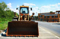 Bulldozer front view on the side of the road Stock Photography