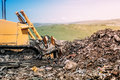 bulldozer levelling garbage grounds. Heavy duty machinery working on construction site Royalty Free Stock Photo
