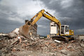 Bulldozer removes the debris from demolition of derelict buildings old Royalty Free Stock Images
