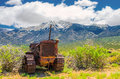 Bulldozer a rusty old junk with the colorado rocky mountains in the background Stock Images