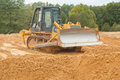 Bulldozer on sand contenporary construction site Stock Photo