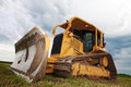 Bulldozer a sitting idle on a construction site shot at an angle Stock Photography