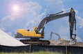 Bulldozer at work scooping dirt working a construction site Royalty Free Stock Images