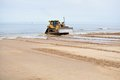 Bulldozer working at seashore Stock Photos