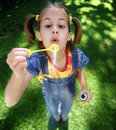 Bulles de soufflement de S-1210-Girl Images stock